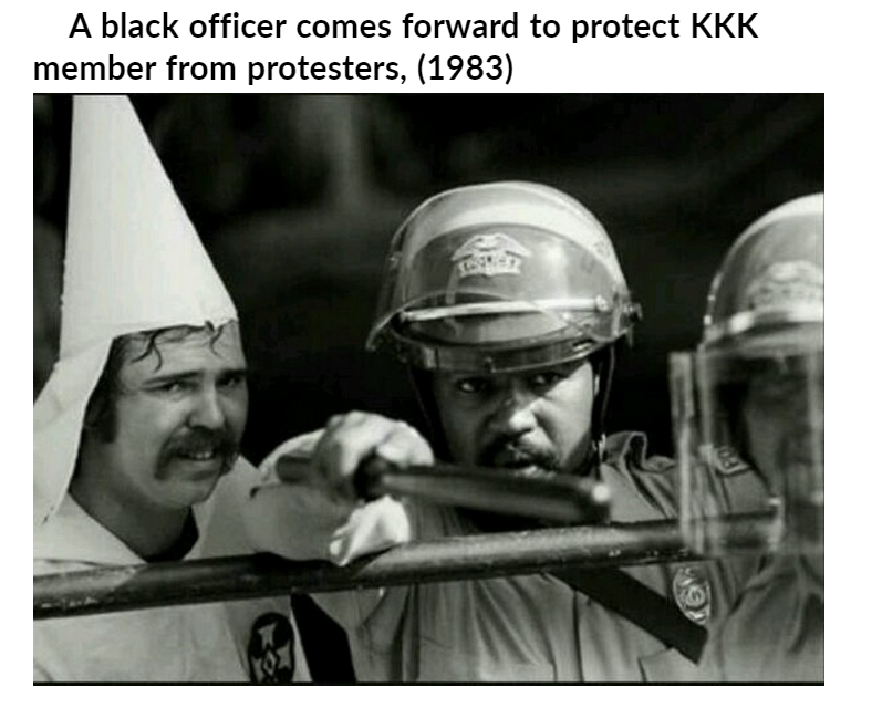 six black officers protect kkk.PNG